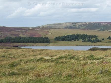 Heathery hillsides above Gorple Lower Reservoir