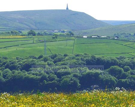 Distant Stoodley Pike on a sunny day