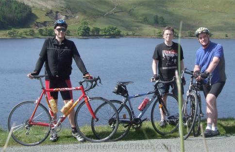 Three cyclists at Widdop Reservoir