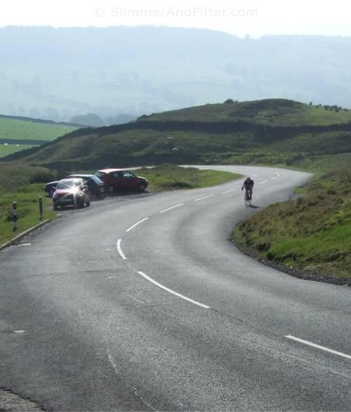 Lone cyclist climbing Nick o' Pendle