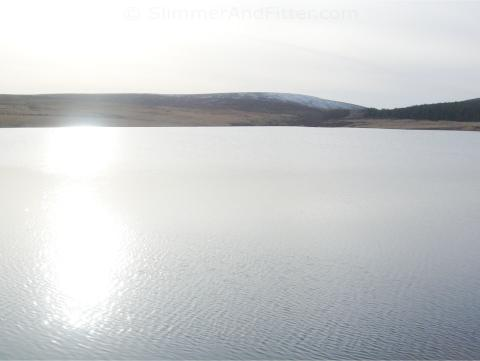 Winter suns reflects off Lower Gorple reservoir
