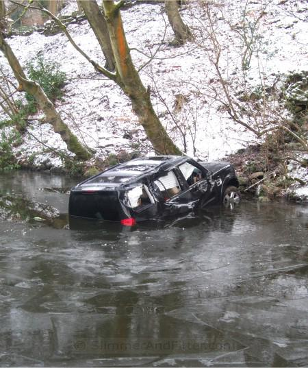 Wrecked car in frozen Rochdale canal