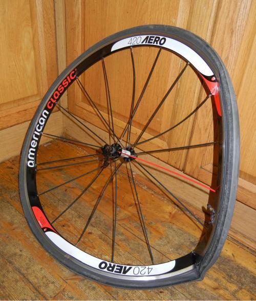Crash-damaged American Classic 420 Aero bicycle wheel